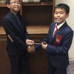 Kam passes the gavel to big brother Kenneth